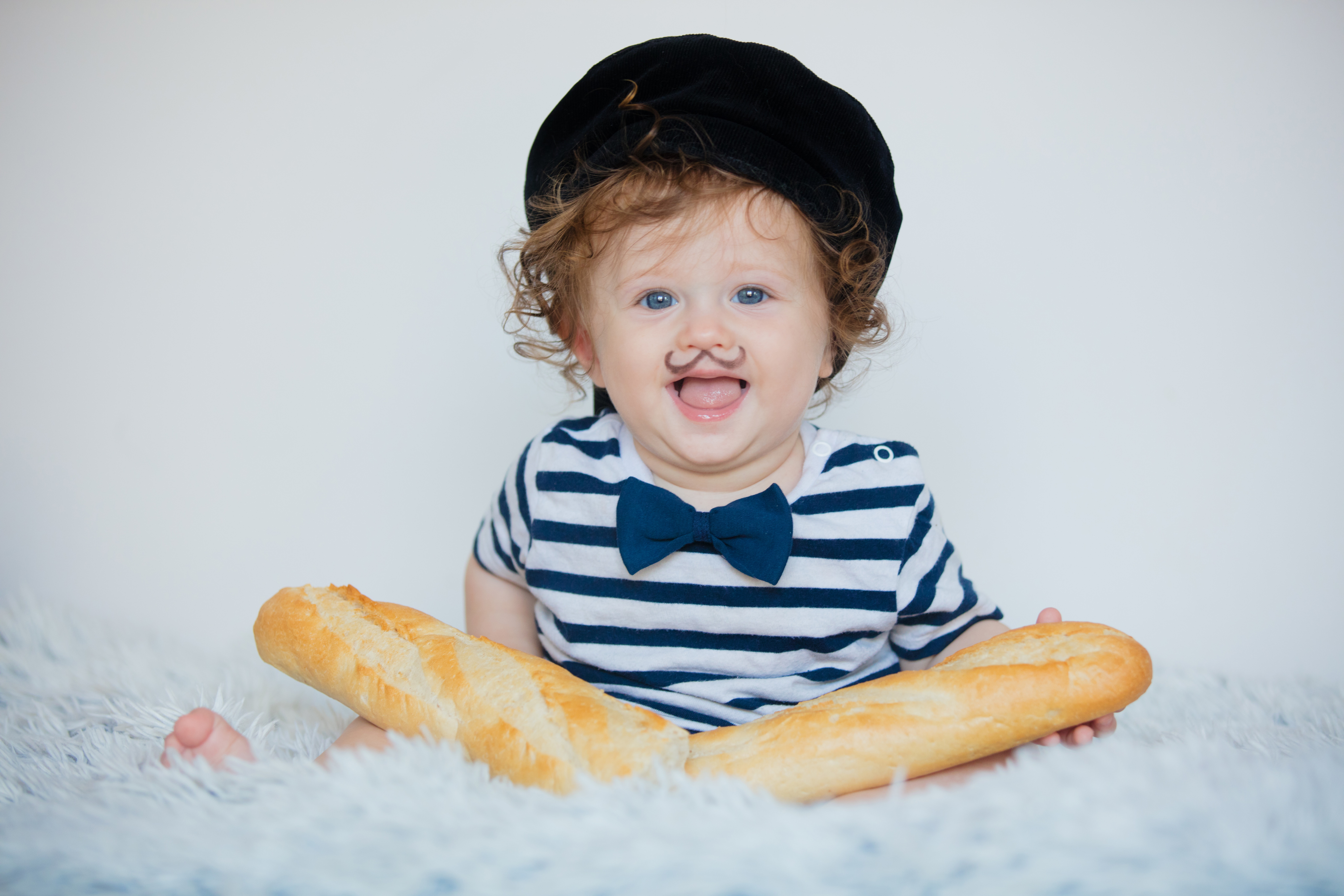 Little baby with mustache, beret and baguette